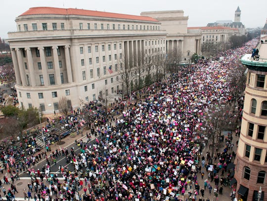 A view of protesters marching on Pennsylvania Avenue