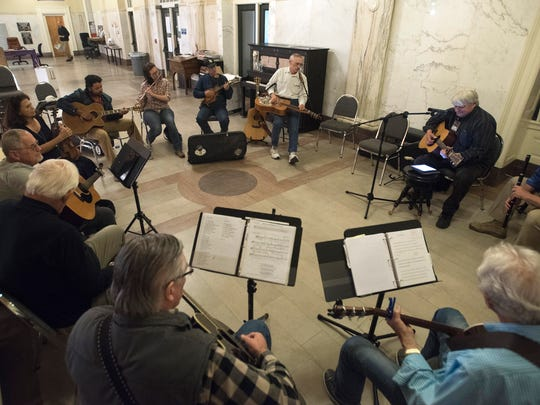 Members of the Pensacola Folk Music Society gather