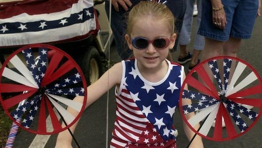 A young American shows her patriotism at the Monroe Rotary Club's annual 4th of July Children's Parade. The year's parade rolls at 9:30 a.m. at Triangle Park