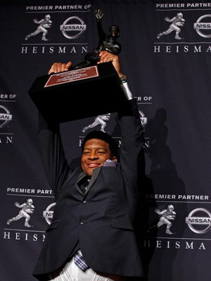 Florida State QB Jameis Winston poses for a photo after being awarded the 2013 Heisman Trophy at the Marriott Marquis in New York City on Saturday,