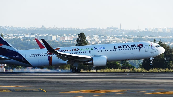A LATAM Boeing 767-300ER aircraft transporting the Olympic flame arrives May 30, 2016, in Brasilia, Brazil. The company settled with U.S. authorities last week a bribery case that involved its Delaware subsidiary.