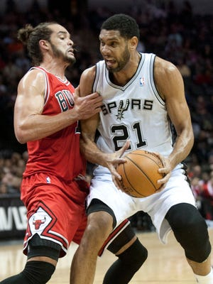Joakim Noah, left, and the Bulls handed Tim Duncan and the Spurs their third straight loss.
