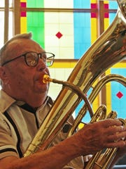 Vern Voigt plays his baritone during rehearsals for the Hope Lutheran brass ensemble's Oktoberfest performance on Oct. 3.
