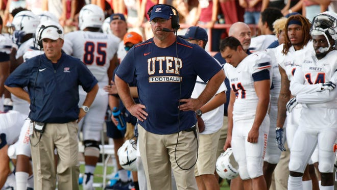 UTEP head coach Sean Kugler can only look on from the sidelines as his team fell further behind in the third quarter 34-7 against the NMSU Agiies.