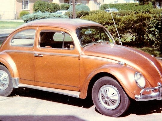 "We asked folks to share their first car with us. Michael Pierson of Thibodaux had a 1964 Volkswagen Beetle that he got during his senior year in high school in 1972. Originally white, the previous owner painted it a 1968 Oldsmobile color called ""burnished bronze.""  Send a picture and info to lguidry@theadvertiser.com to see it in this gallery or Times of Acadiana."