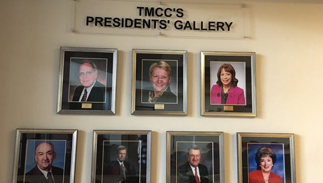 A wall showing seven of the eight presidents that have led TMCC.
