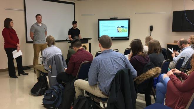 University of Wisconsin-Oshkosh students presents their findings Dec. 6 of a Lake Winnebago shoreline restoration study to city officials.