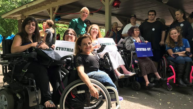 Cynthia Nixon photographed with members of disability rights groups during a visit to Rochester on June 10.