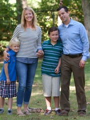 Caeden Stoll (left), with mom Shannon, brother Ryan, 8 and dad Matthew.