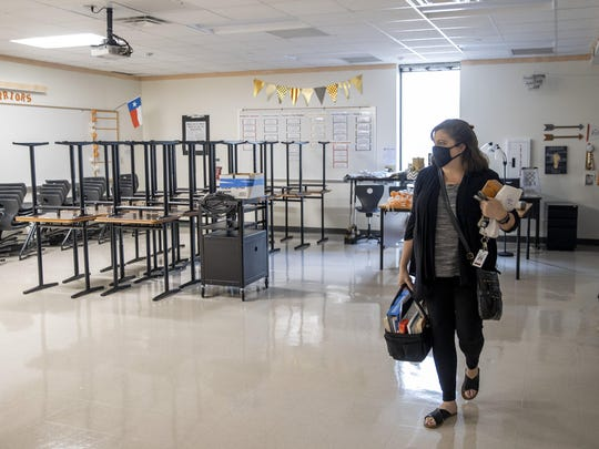 Westwood High School teacher Tamra Franklin in Austin, Texas, is teaching her students virtually, not knowing when she'll return. Since the coronavirus pandemic shuttered schools in mid-March, educators have grappled with a plan for reopening.