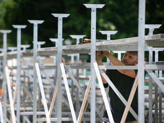 Kyler Scheerer with First State Fabrication continues work on the new bleachers at Baynard Stadium.