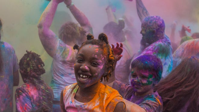 Girard Park was filled with revelers for the 7th annual Lafayette Holi Festival, Saturday, March 25, 2017. The Holi Festival is a Hindu celebration of Spring which uses colored powders to symbolize good winning over evil.