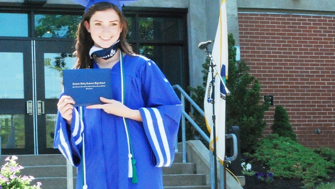 Olivia L'Italien of Chelmsford graduates from the dental assisting program at Nashoba Valley Technical High School in Westford, in a ceremony held June 6 at the school.