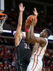 Iowa State guard Deonte Burton puts up a shot over Nebraska-Omaha forward Daniel Meyer during the first half of an NCAA college basketball game, Monday, Dec. 5, 2016, in Ames, Iowa. Burton scored the first 13 points for Iowa State.