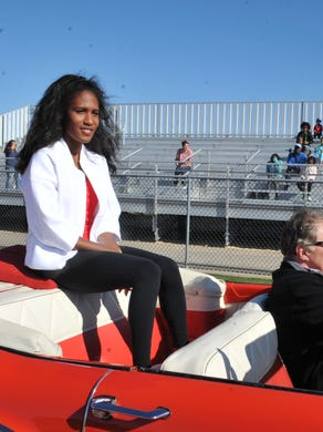 Olympian and Neptune native Ajee' Wilson enters the track during the Neptune Township Board of Education event in her honor.