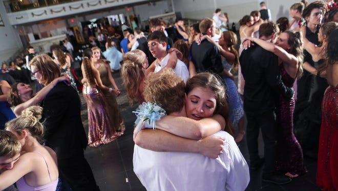 Teens danced arm-in-arm in one of the few slow songs during the 2020 'Starry Nights' prom for New Albany junior and seniors Friday night. The dance was put on by a few parents who wanted to give the seniors -- in the era of Covid-19 -- a chance to experience what many consider a rite of passage as a teen.