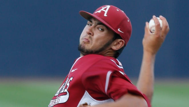 Arkansas' Chris Oliver delivers a pitch in the first inning during an NCAA college baseball regional game against Liberty in Charlottesville, Va., on Friday.(AP Photo/Steve Helber)