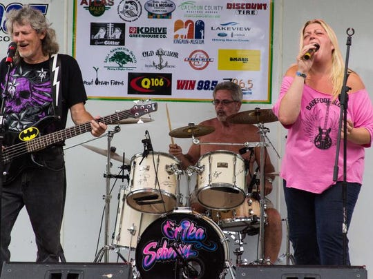 From left, Rusty Parker, Tom Hall and Julie Lahr of Barefoot Blonde perform at the 2014 Leilapalooza.