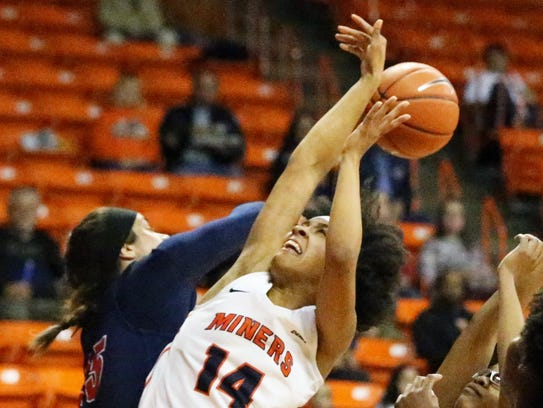 UTEP guard Najala Howell gets the ball batted away