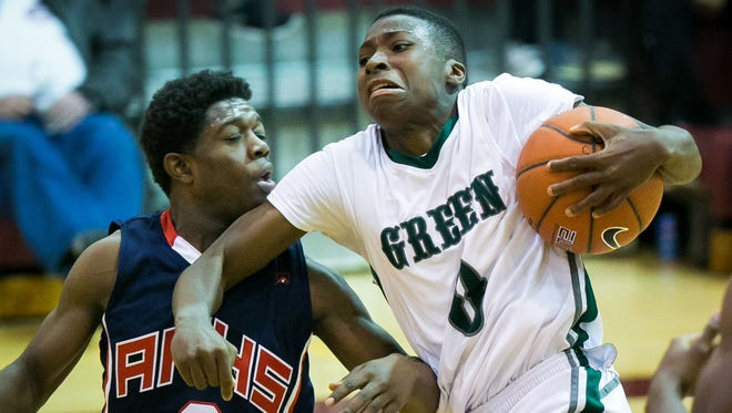 Raheim Burnett of Mount Pleasant collides with Papie Roberts of American History late in the second half.