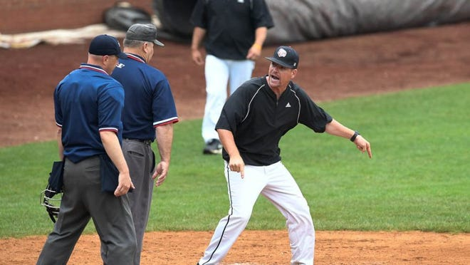Josh Heldt, arguing a call during  2016 Class 4A regional at Bosse Field, has stepped down as Harrison baseball coach.