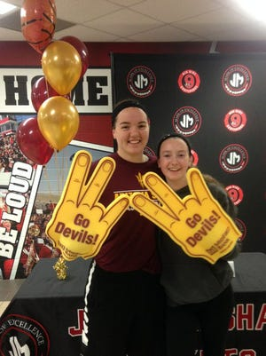 Jamie Ruden, left, celebrates with her sister Wednesday after signing with Arizona State women's basketball.