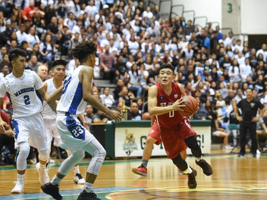 St. John's player Michael Min (0) drives to the basket