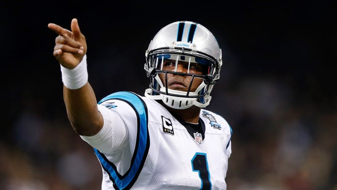 Panthers quarterback Cam Newton threw five touchdown passes on Sunday.