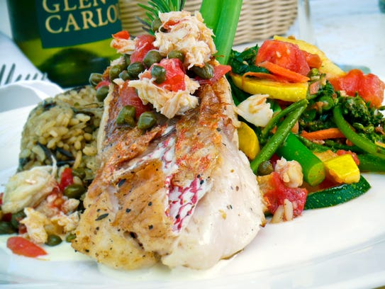 Pan-fried scarlet snapper topped with crab is a dinner