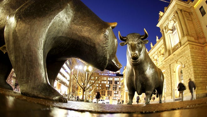 The bull and bear bronze statue stands outside the stock market in Frankfurt, Germany.