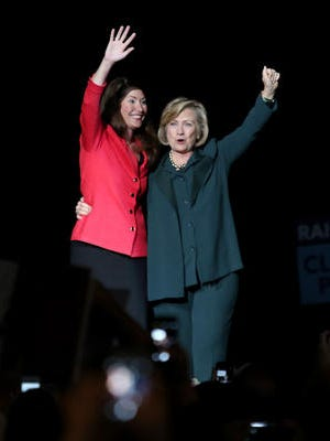 Alison Lundergan Grimes and Hillary Clinton at The Bank of Kentucky Center at Northern Kentucky University.