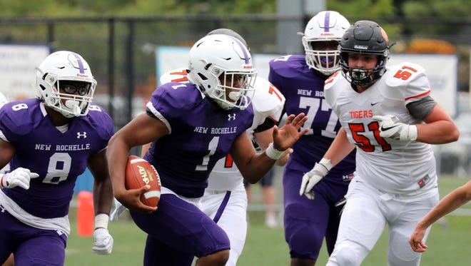 New Rochelle's Jonathan Saddler runs with the ball during the New Rochelle vs. Mamaroneck football game at Joseph F. Fosina field at Flowers Park in New Rochelle, Sept. 2, 2017.