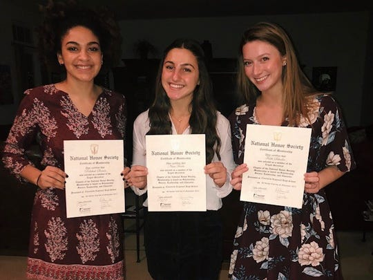 Clearview student Rebekah Strauss (left) is shown with her National Honor Society certificate. She's shown with fellow students Faith Schusler and Nina Freda. Strauss recently earned a top prize from the Princeton Prize in Race Relations for her efforts to improve race relations at Clearview. She helped organize a sit in last year after students had made offensive and racist social media posts and later helped start a student coalition which makes ongoing efforts to increase diversity and improve race relations at the school.
