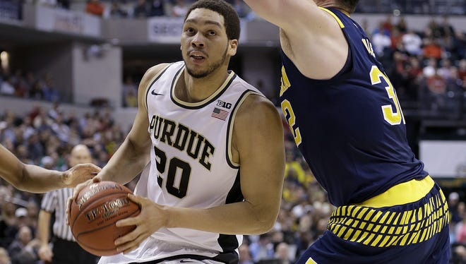 Purdue Boilermakers center A.J. Hammons (20) drives on Michigan Wolverines forward Ricky Doyle (32) in the first half of their Big Ten Men's Basketball Tournament semifinal game Saturday, Mar 12, 2016, afternoon at Bankers Life Fieldhouse. The Purdue Boilermakers defeated the Michigan Wolverines 76-59.