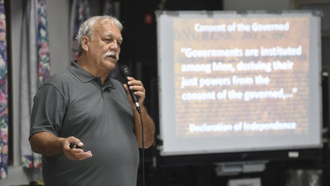 In this file photo, Ken Leon-Guerrero, spokesperson for Citizens for Public Accountability, gives a presentation to members of the community about pay raises for elected officials at the Santa Rita Senior Citizen Center on April 13.