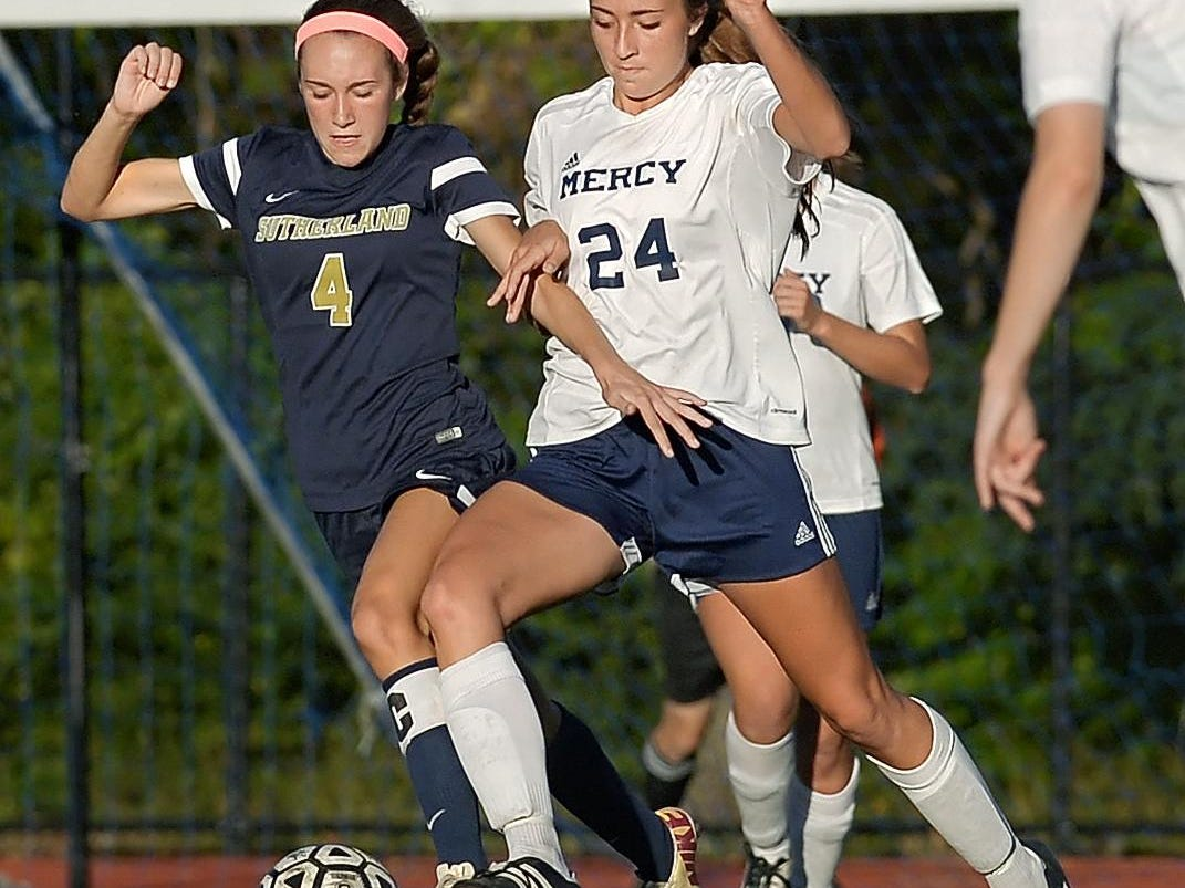 Mercy's Aileen Dalton, right, tries to shield Pittsford Sutherland's Grace Dunnigan off the ball.