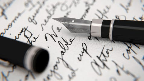 A stock image of a handwritten letter and a fountain pen.