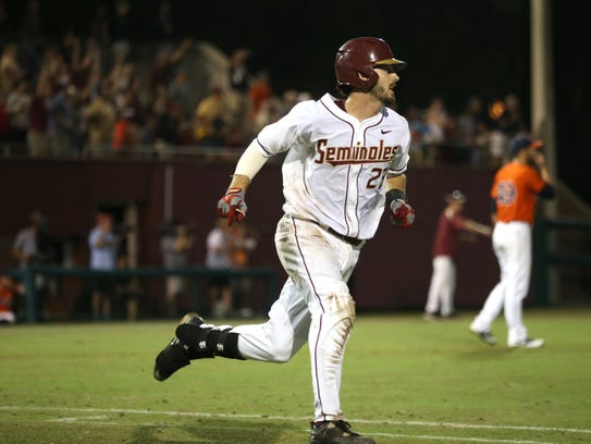 FSU's Dylan Busby watches his hit reach the outfield