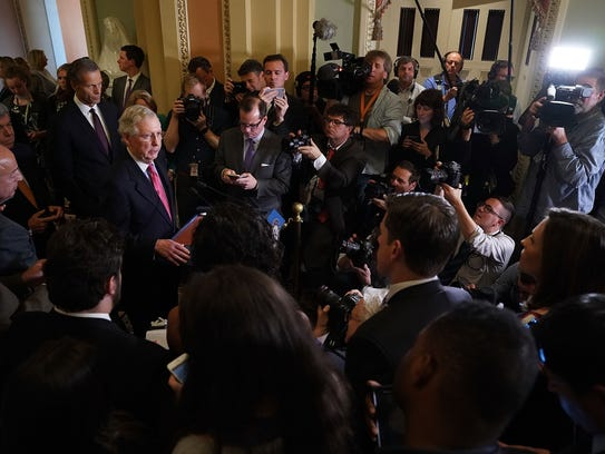 Senate Majority Leader Mitch McConnell talks to reporters