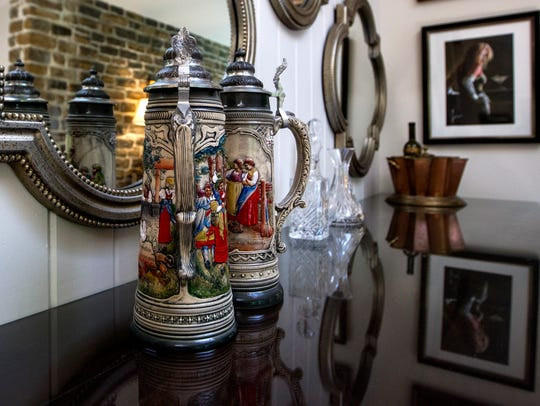 Beer steins sit atop the bar in the living room at