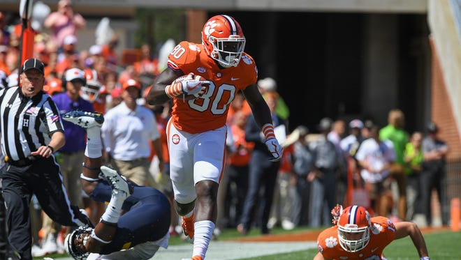 Clemson tight end Milan Richard (80) races down field after a reception and a big block by teammate wide receiver Hunter Renfrow (13) and Kent State linebacker Jim Jones (22) during the 1st quarter on Saturday, September 2, 2017 at Clemson's Memorial Stadium.