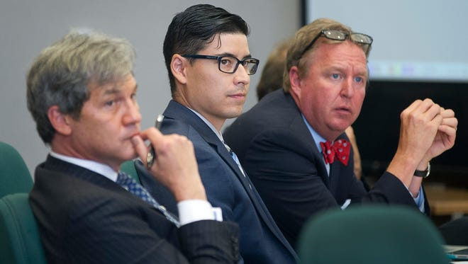 Tai Chan sits in court between his defense council during testimony Thursday afternoon.