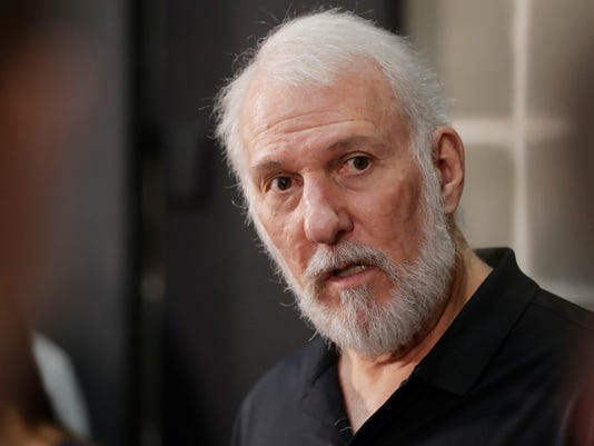 "FILE - In this Sept. 25, 2017, file photo, San Antonio Spurs head coach Gregg Popovich answers questions during media day at the team's practice facility in San Antonio. Trump told The Nation magazine on Oct. 16, 2017, that President Donald Trump ""a  soulless coward who thinks that he can only become large by belittling others"" in response to Trump's comment Monday that former President Barack Obama and other commanders-in-in chief ""didn't make calls"" to families of fallen soldiers. Former Obama staffers and a spokesman for former President George W. Bush pushed back on Trump's comments. The White House press secretary said that Trump wasn't criticizing his predecessors. (AP Photo/Eric Gay, File)"