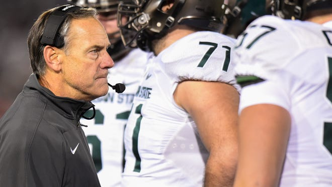 Michigan State coach Mark Dantonio looks on during a time-out against the Penn State on Nov. 26.
