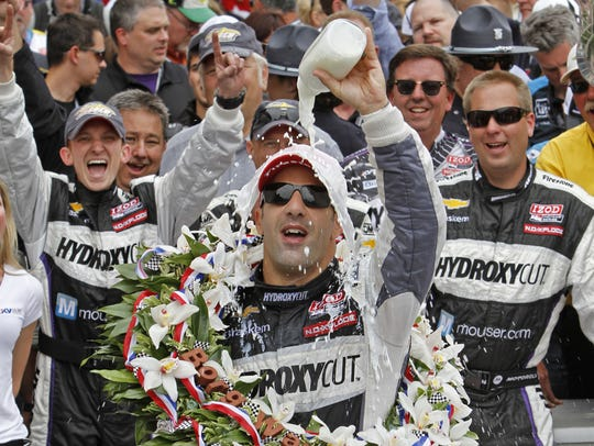 Tony Kanaan soaks in his 2013 Indy 500 victory by pouring milk on himself.