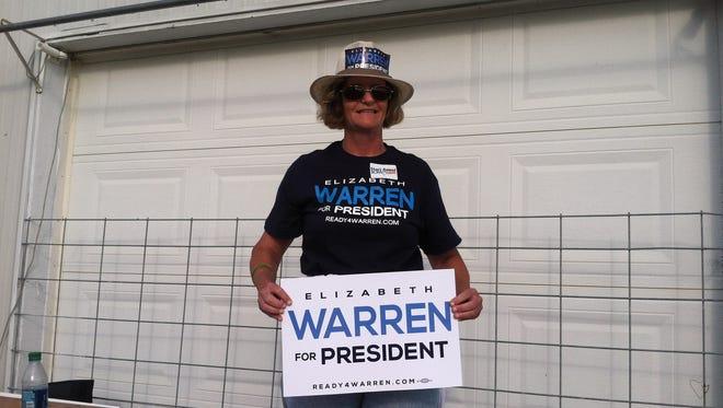 "Brenda Brink, a volunteer with ""Ready for Warren,"" works at the Harkin Steak Fry."