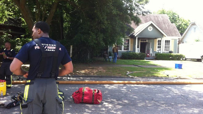 Firefighters work a house fire on the 1600 block of Madison Ave.