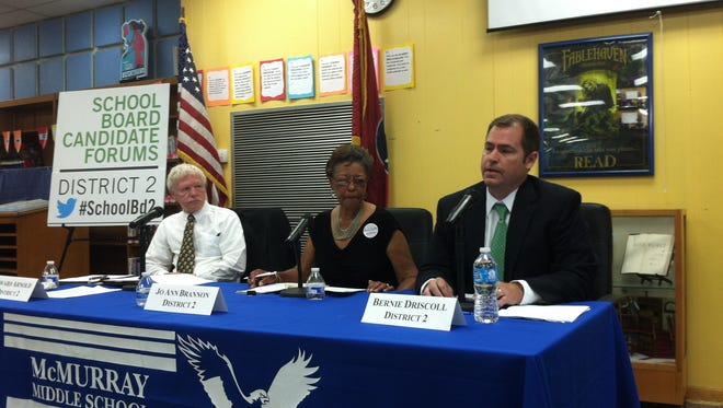 Bernie Driscoll, right, discusses his candidacy for the Metro school board District 2 seat, currently held by Jo Ann Brrannon, middle, and also sought by Eddie Arnold, left.