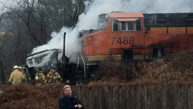 Emergency personnel respond to a freight train that hit a car carrier on Western Highway in West Nyack, Dec. 6, 2013. The tank cars were empty, but had been carrying volatile Bakken crude.