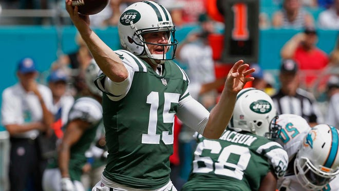New York Jets quarterback Josh McCown (15) looks to pass during the first half of an NFL football game against the Miami Dolphins, Sunday, Oct. 22, 2017, in Miami Gardens, Fla. (AP Photo/Wilfredo Lee)